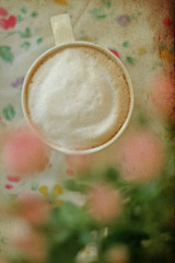 vertical image of  cappucino with candies