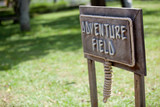 Adventure field wooden sign board poster