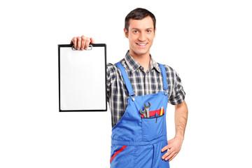 A repairman holding a blank clipboard