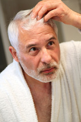 Senior man with hair loss problems
