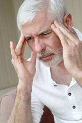 Senior man having a headache