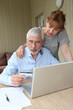 Senior couple doing online shopping