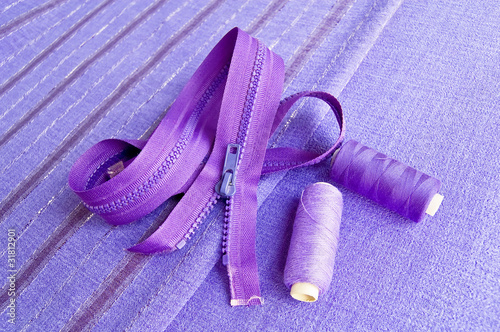 Locking zipper and thread on the purple fabric