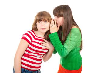 Two school girls whisper