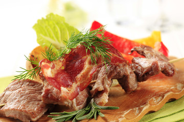 Roasted meat on wooden skewer