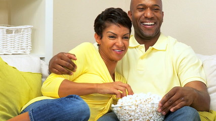 Ethnic Couple Relaxing With a Movie & Popcorn