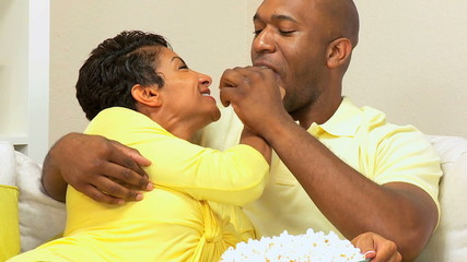 African-American Couple at Home Eating Popcorn