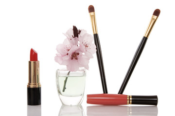 cosmetics and cherry flower