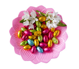 white beautiful decorative flowers on a dish with colorful foile