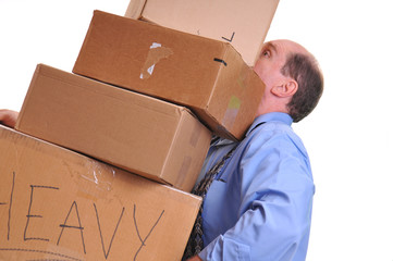 Man carrying heavy boxes hoping not to drop them