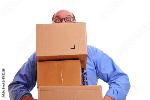 Man peeps over heavy boxes while carrying them in arms
