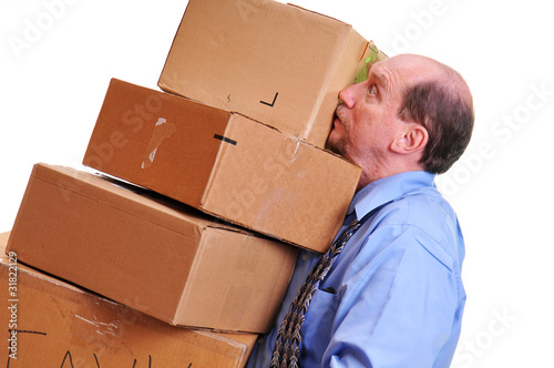 Man carrying heavy boxes leaning against him