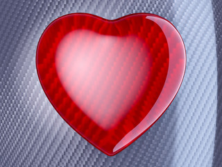 Red heart shape over carbon fibre