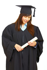 Woman in gown holding the diploma isolated