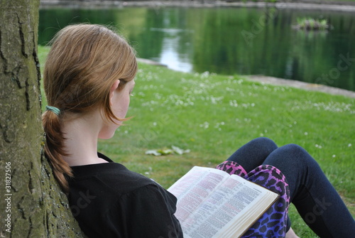 Child studying Holy Bible