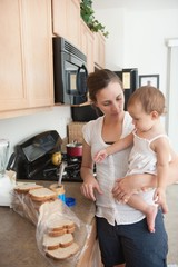 A Mother Making A Sandwich For His Baby Girl