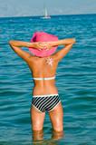 Young girl enjoying the sun poster