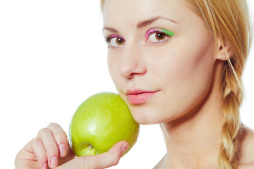 portrait of young woman with green apple isolated on white