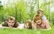 Happy Family outdoor lying on green grass