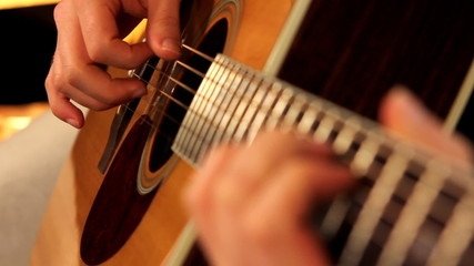 man playing guitar close up