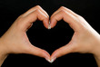 Heart shape formed by female hands