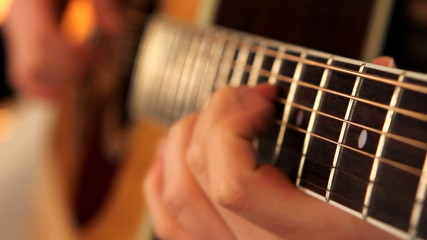 man playing guitar close up 2