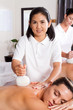 professional masseuse giving Thai massage