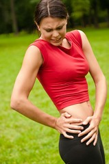 Buttocks injury - sportswoman in pain