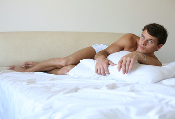 Young Sexy Man on a Bed