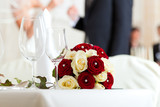 Table at a wedding feast poster