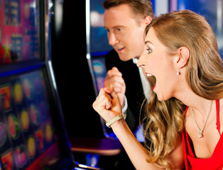 Couple in Casino on slot machine