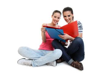 two cute young women reading