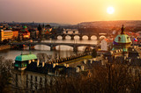 Panoramic view on Charles bridge and sunset Prague lights.