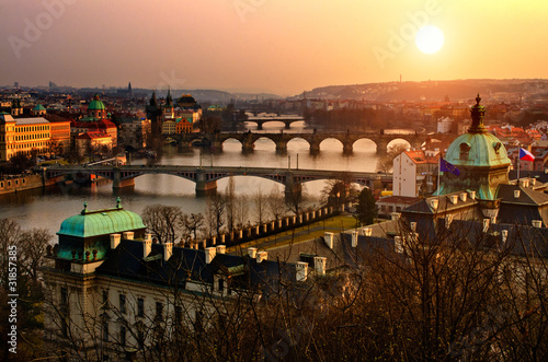 Aluminium Praag Panoramic view on Charles bridge and sunset Prague lights.