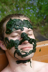 algae mask on man's face