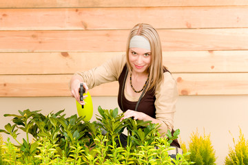 Gardening woman watering plants in spring