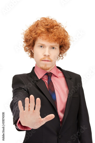 man making stop gesture