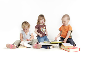 group of toddlers reading books