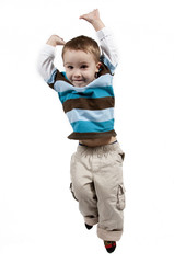 Adorable little boy jumping in air. isolated on white backgrou