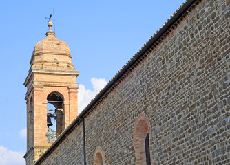 Clocktower and church wall, Montepulciano, Tuscany