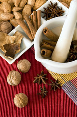 Nuts and spices on kitchen table.