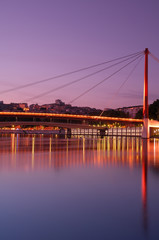 "The ""Palais de Justice"" bridge in Lyon at dusk"