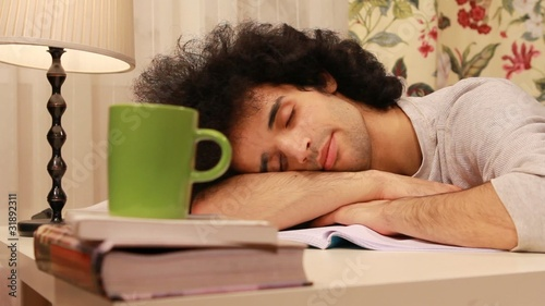 young man falling on a sleep while studying 2