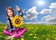 Mädchen auf Blumenwiese Sonnenblume