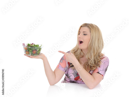 Casual woman eating healthy green vegetable salad. isolated on w