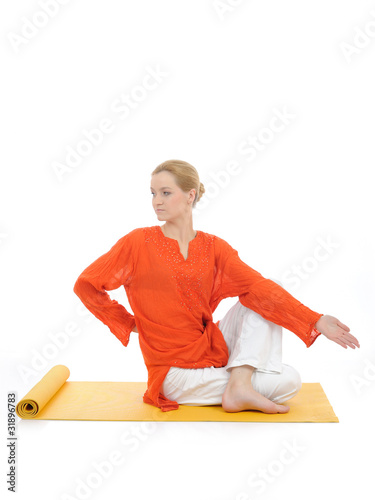 series or yoga photos. young woman doing yoga pose on yellow pil