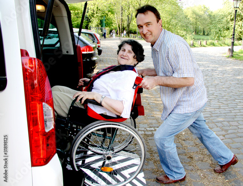 Leinwanddruck Bild senior woman in wheelchair