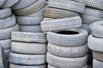 the white automobile tires dumped in a a big pile