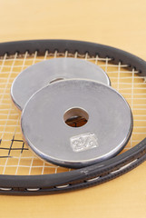 Disc Weights on Tennis Raquet