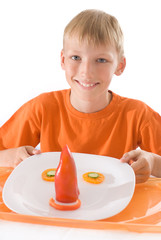 boy holding a plate with vegetables